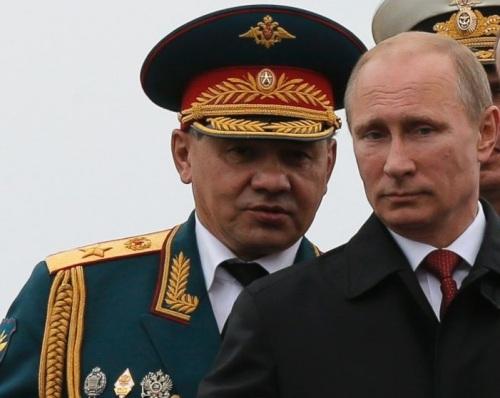 Sergei Shoigu (l) and Vladimir Putin (r)